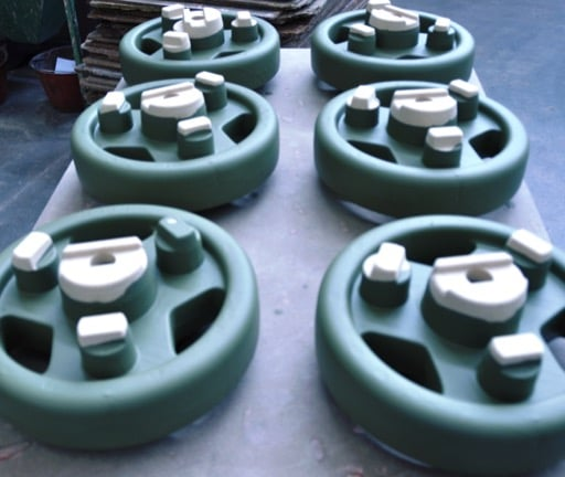 green and white wheels used for refractory coatings