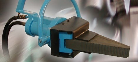 a blue and brown promat hydraulic breaker