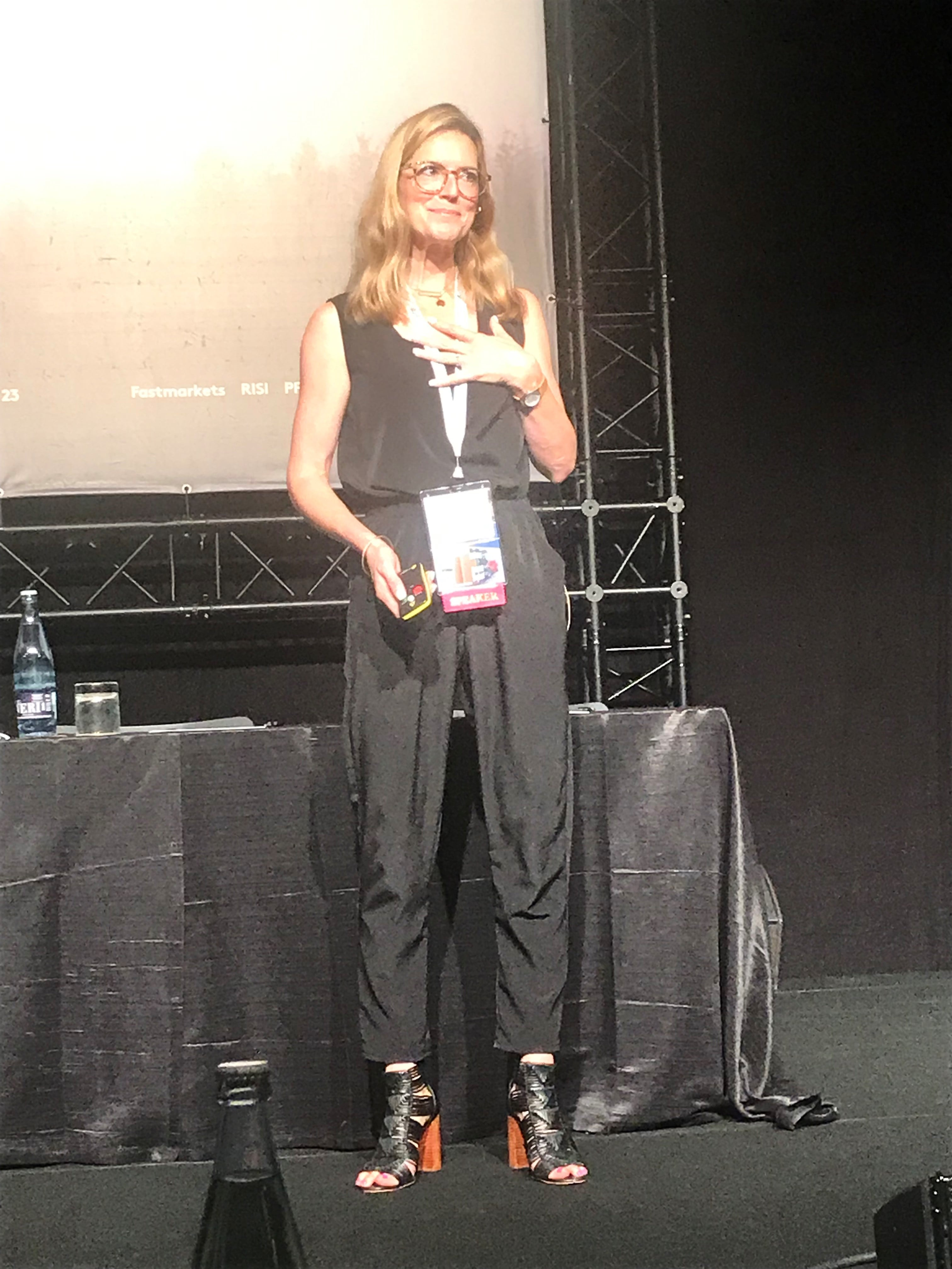 woman speaking on stage