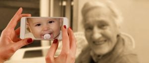 Anti-aging implied by depicting an old woman having a photo taken and photo looks like a baby